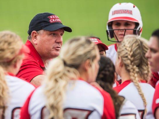 Head softball coach Gerry Glasco talks to his Ragin'