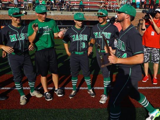Mason pitcher Nick Northcut displays the regional championship