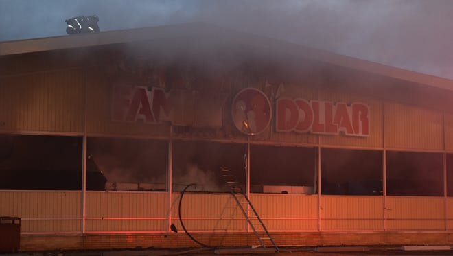 Firefighters work to put out blaze Jan. 28, 2016, at a Family Dollar Stores location at 4540 N. Shadeland Ave., Indianapolis. Investigators say the fire was intentionally set.