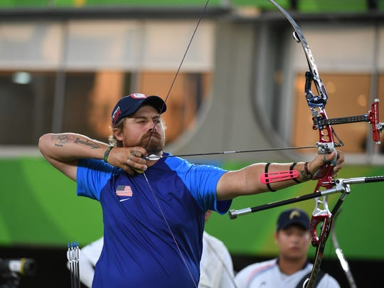 Aug 6, 2016: Brady Ellison (USA) takes aim in the men's team gold medal match at Sambodromo during the Rio 2016 Summer Olympic Games.