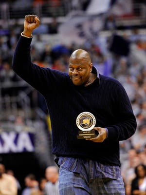 Former NBA and Georgetown basketball player Patrick Ewing acknowledges the crowd after he was recognized with an award during a ceremony at the NCAA college basketball game between Georgetown and Syracuse, in Washington. A person with direct knowledge of the situation says former Georgetown star Patrick Ewing has been hired to coach the school's basketball team, more than two decades after he led the Hoyas to their only national championship as a player. The person spoke to The Associated Press on condition of anonymity because the school has not announced the hire.. (AP Photo/Nick Wass, File)