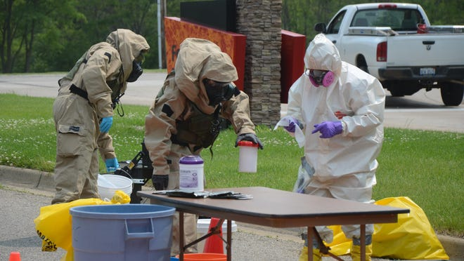 A container containing what might have been anthrax powder was placed in another container and after it was removed from a bank robber's pickup truck Tuesday afternoon at Hill Brady Road and Skyline Drive.