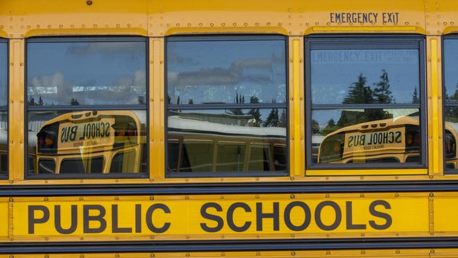 Springfield Public Schools buses are ready to roll whenever school children will be able to return to the classroom.  [Andy Nelson/The Register-Guard] - registerguard.com