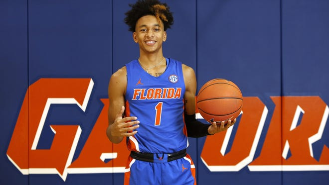 Tre Mann is returning to Florida for his sophomore season.