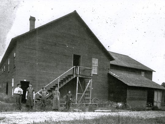 In 1903, this was the newly constructed Muir & McDonald tannery. The previous tannery had burned and it was reconstructed when Dallas citizens contributed money, materials and labor to rebuild it. Standing in front of the tannery, from left to right, is Andrew B. Muir, Dave S. McDonald and Andrew's son, Walter S. Muir.