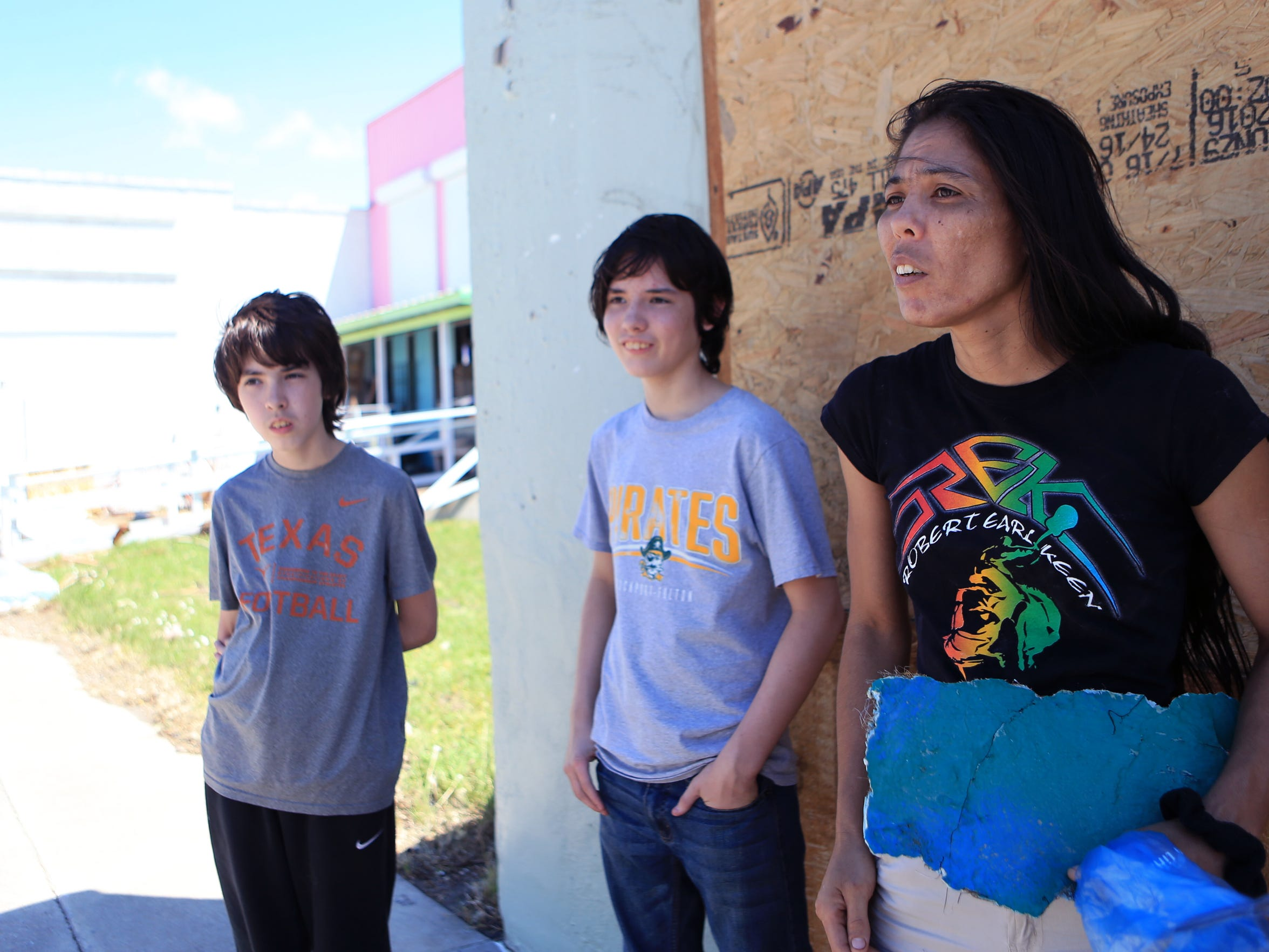 The Allgood family, Ryan (from left), 14, Zak, 15, and Emiko stayed in their home through Hurricane Harvey in Rockport, TX. They are packing up a trailer and leaving town for good.