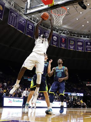 LSU Tigers forward Duop Reath (1) shoots a lay up against North Carolina-Wilmington Seahawks forward Devontae Cacok (15) during the second half at Pete Maravich Assembly Center.