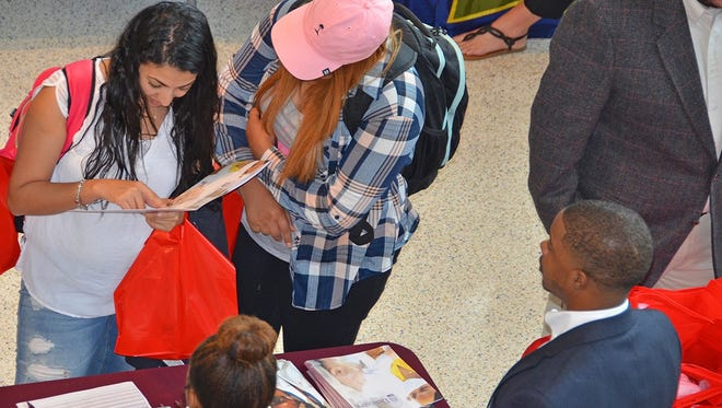 At the Meharry College vendor table during the MTSU Chemistry Career Fair Sept. 29 in the Science Building, Nivin Ghatas, left, a junior biochemistry major from Nashville, points out something in a brochure to Mariam Hanna, a junior pre-diagnostic medical sonography major from Nashville.