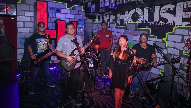 The Band, Bellarin performing on Aug, 15, 2017 at Livehouse, Tumon. From left:  Arick Zantua, bass; Fernan De Vera, lead guitar; Ong Lopez, drums;  Jonnavie Abaya, vocals and Maria Grace Manalili, rhythm guitar.