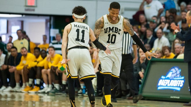 Jairus Lyles' celebartes after hitting a 3-pointer right before the end of the first half. He added another one with 0.5 seconds left in the game to send UMBC to the NCAA tournament.