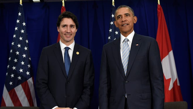 In this Nov. 19, 2015 file photo, President Obama and Canadian Prime Minister Justin Trudeau stand up following their bilateral meeting at the Asia-Pacific Economic Cooperation summit in Manila, Philippines. The White House says Trudeau will attend a state dinner on March 10 in a visit intended to boost ties between the neighboring countries.