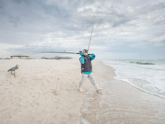 August Schmidt, of Perdido Key, fishes along the shore