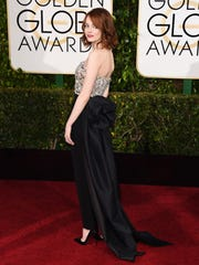 Emma Stone arrives at the 72nd annual Golden Globe Awards at the Beverly Hilton Hotel on Sunday, Jan. 11, 2015, in Beverly Hills, Calif. (Photo by Jordan Strauss/Invision/AP)