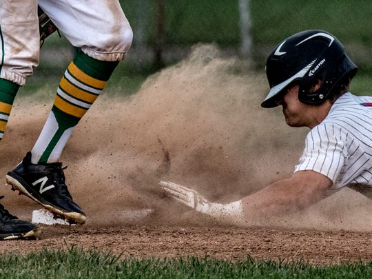Tristan Warthman of Lakewood, playing for the big school team, slides safely into third base with a triple during the Licking County All-Star baseball game at Don Edwards Park Saturday night.