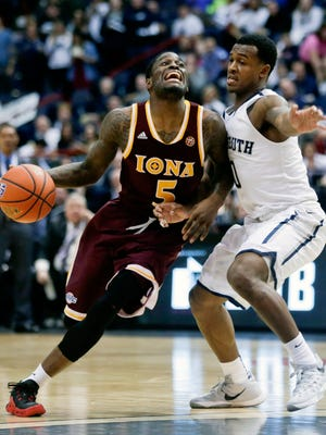 Iona guard A.J. English (5) drives on Monmouth guard Josh James during the second half of an NCAA men's college basketball game in the championship of the Metro Atlantic Athletic Conference tournament on Monday, March 7, 2016, in Albany, N.Y. Iona won 79-76. (AP Photo/Mike Groll)