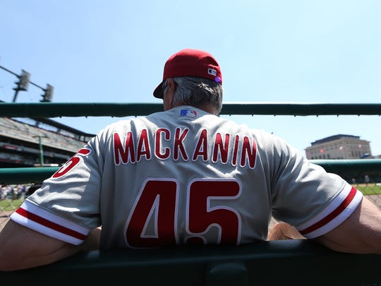 Phillies manager Pete Mackanin sits in the dugout prior to the start of the interleague game against the Detroit Tigers on May 25, 2016 at Comerica Park in Detroit.