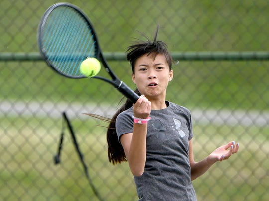 Gracie Pfieffer hits a forehand return while winning the girls 14 title without losing a game in the 84th News Journal/Richland Bank/matchmatetennis.com Tennis Tournament at Lakewood Racquet Club.