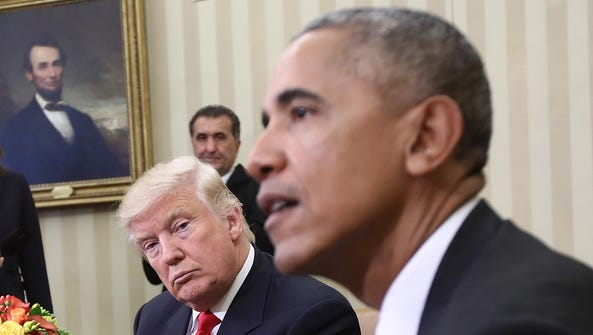 President-elect Donald Trump listens as President Obama