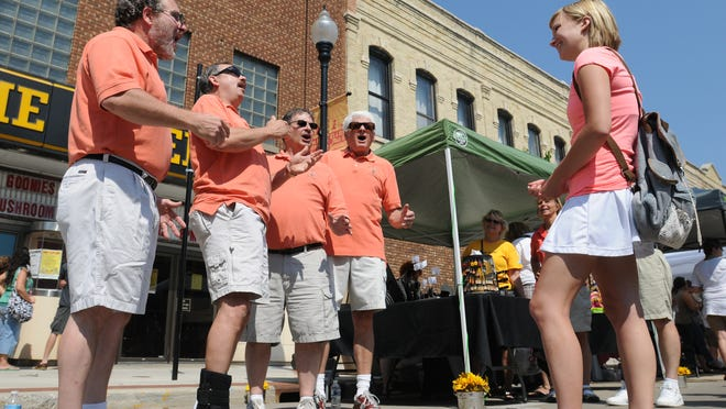 The Westhaven Quartet, one of several quartets consisting of members from the Winnebagoland Barbershop Chorus, singsto Petra Krause on her 20th birthday during the Oshkosh Saturday Farmer's Market July 6, 2013.