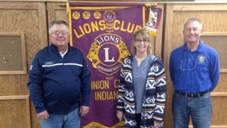 Ceann Bales, director of the Randolph County YMCA, presented a program about Indiana's bicentennial celebration during the Union City, Ind., Lions Clubs meeting Oct. 13. She is pictured with Gary Miller (left), program director of the Lions Club, and Rick Lacey, the club's president