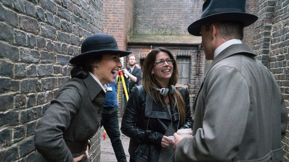 Director Patty Jenkins, center, has fun on set with