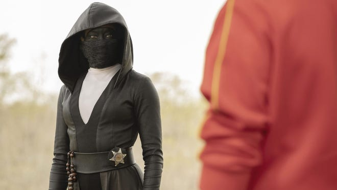 "Regina King is a police officer turned masked vigilante in ""Watchmen."""