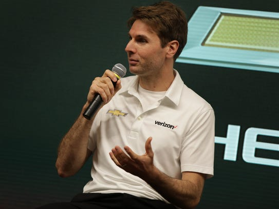 Race car driver Will Power speaks during a press conference