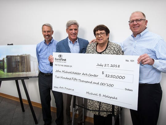 Bank First Chief Executive Officer Michael Molepske (second from left) and Bank First Sheboygan Market President Richard Balge (far right) present a $250,000 donation supporting the John Michael Kohler Arts Center's Art Preserve to Arts Center Director Sam Gappmayer (far left) and Arts Center Director of Strategic Initiatives/Director Emerita Ruth DeYoung Kohler (second from right).
