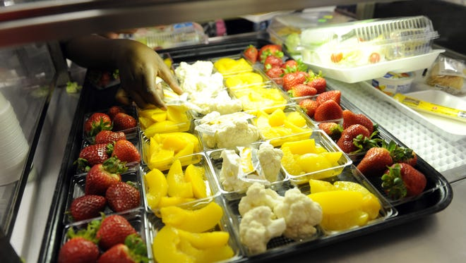 Fruit and vegetables are served during lunch at the Patrick Henry Elementary School in Alexandria, Va.
