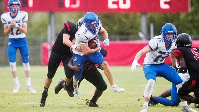 Barron Collier High School's Drew Powell breaks free from South Fort Myers defenders during second quarter play on Thursday, May 17, 2018 at South Fort Myers High School in their spring game. South won, 27-7.