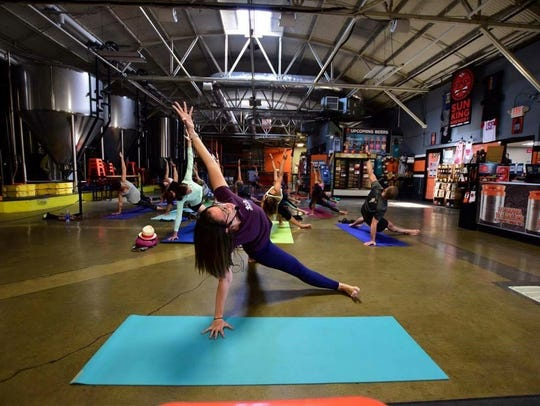 Community Yoga at Sun King Brewery's tasting room.