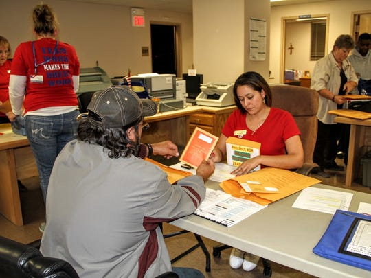 County Clerk staff count ballots from Precinct 38 on