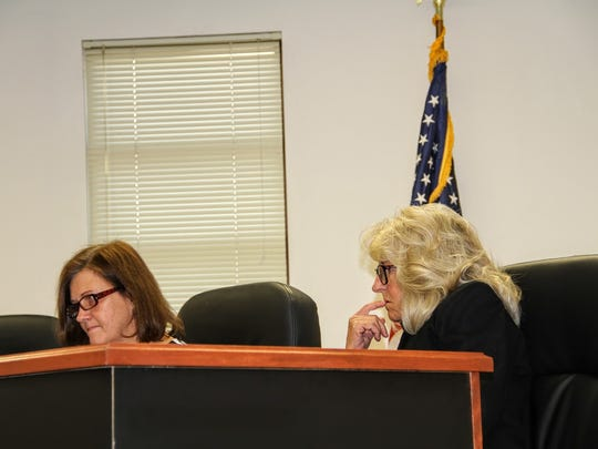 Commissioners Susan Flores and Janet White review letters written to former commissioners regarding Butterfield Trail at their Nov. 10 regular commission meeting.
