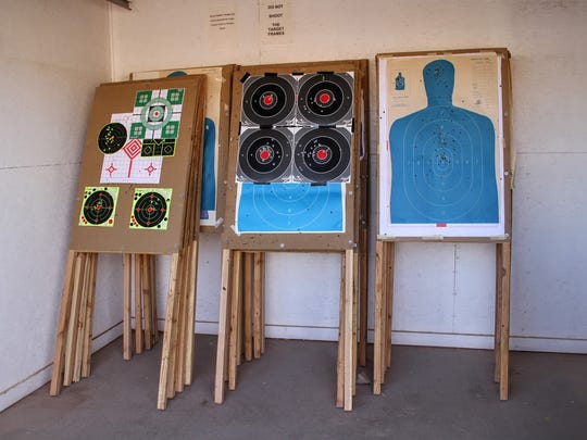 Shooting targets are placed in storage at the Sidney Paul Gordon Shooting Range in La Luz Tuesday.