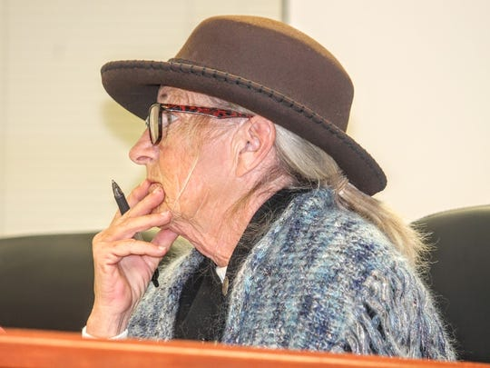 Commissioner Janet White listens to the Forest Service's proposal for the Rio Peñasco area at their special meeting Monday.