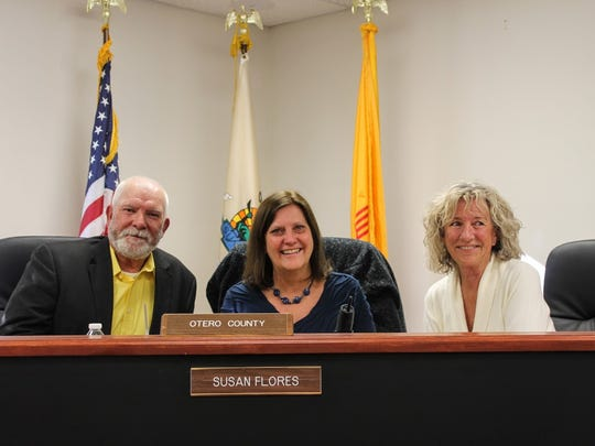 Commissioners Ronny Rardin, Susan Flores and Janet White sit for a photo at their last meeting together as county commissioners Friday, Dec. 9.