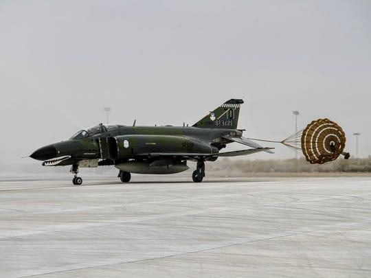 An F-4 Phantom II makes a landing at Holloman Air Force Base during its final flight Wednesday, Dec. 21.
