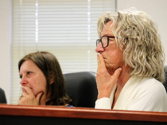 Commissioners Susan Flores and Janet White go over SRS Title III funding. White expressed concerns over meetings regarding planning in Otero County at their Friday, Dec. 9 meeting.
