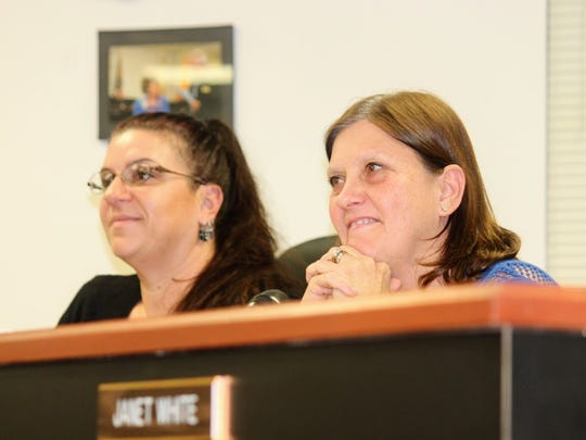 Commissioners Lori Bies and Susan Flores listen to members of the audience give their opinion for the location of the judicial complex at their special meeting Wednesday evening.