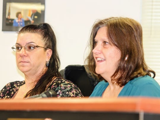 Commissioner Lori Bies, left, and Susan Flores, right,