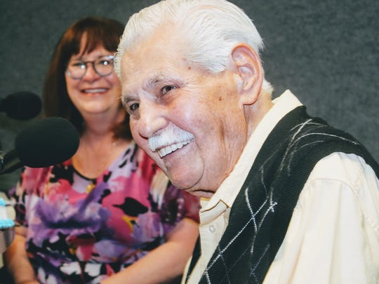 """Local radio DJ Ron Johnson smiles as he speaks about his long lasting career in the radio broadcasting business during Nadia Sike's radio show """"Community Corner."""""""