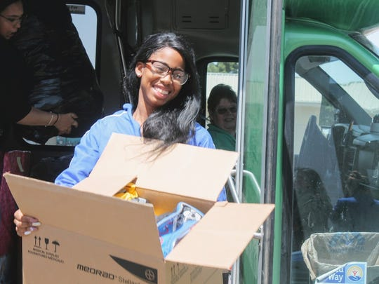 A Junior Leadership Otero advocate unloads a box of toiletries for the Children, Youth and Families Department Monday.