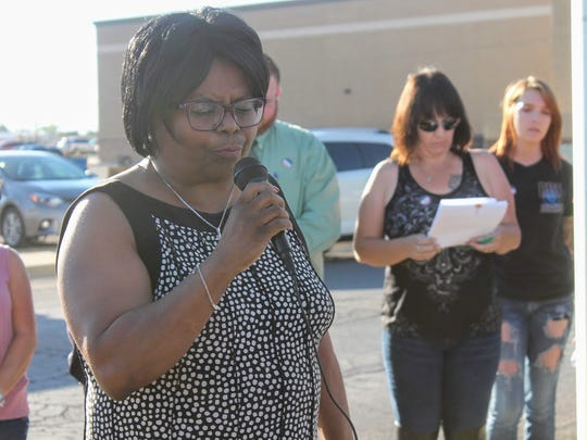 Otero County Probate Judge Latanya Boyce says a prayer in honor of National Day of Prayer Thursday, May 4, at City Hall.