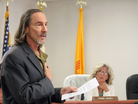 Otero County concerned resident Styve Homnick reads a statement from the Apache Guardians of the Otero Mesa of their opposition to the deep borehole project Friday, May 12.