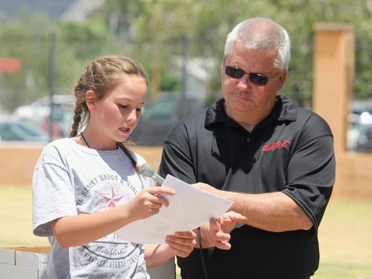 Fifth-grader Sydney Lessentine from Buena Vista Elementary School read her winning essay out loud Wednesday afternoon at Alameda Park Zoo. Lessentine's essay will be entered in a statewide competition that recognizes D.A.R.E. students.