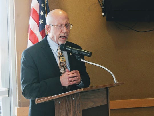 First National Bank President Steve Muell says a prayer for the Manchester bombing victims at the Alamogordo Chamber of Commerce military and civilian luncheon Tuesday.