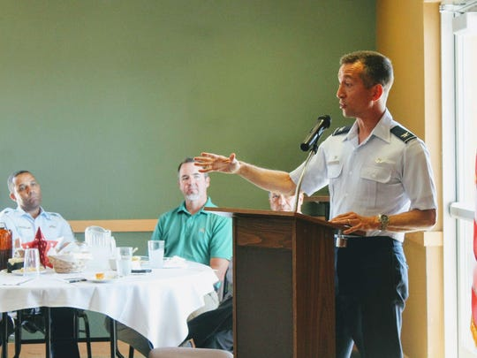 Holloman's 49th Wing commander Col. Houston R. Cantwell discusses the F-16 squadron relocation from Hill Air Force Base at the Alamogordo Chamber of Commerce military and civilian luncheon Tuesday.
