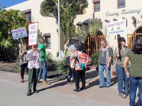 In this May 12 file photo, protesters stand outside the Otero County Commission Building, 1101 N. New York Ave., showing their opposition to the Salt Basin Deep Borehole Research Project.