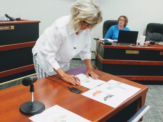 County Commission Chairman Janet White sorts out the top logos during Thursday's June 8 regular Otero County Commission meeting.