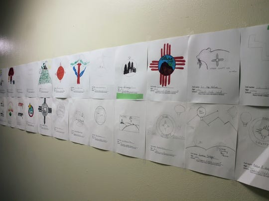 All the entries that students all across Otero County submitted for the county logo contest are hanged on the wall at the Otero County Administration Building, 1101 N. New York Ave.